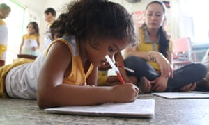 A Sobal child writing