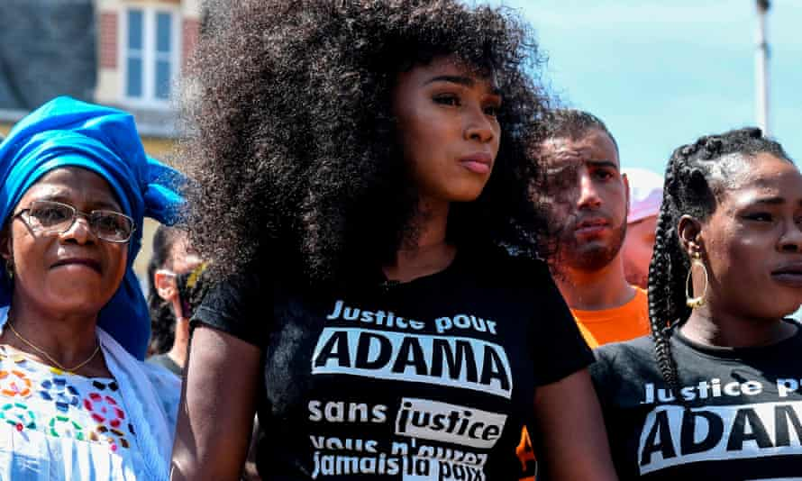 Assa Traoré stands alongside her mother Oumou and sister Hawa before the protests commence.