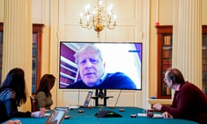 Boris Johnson chairing a coronavirus meeting by videolink on 28 March while he was in isolation.