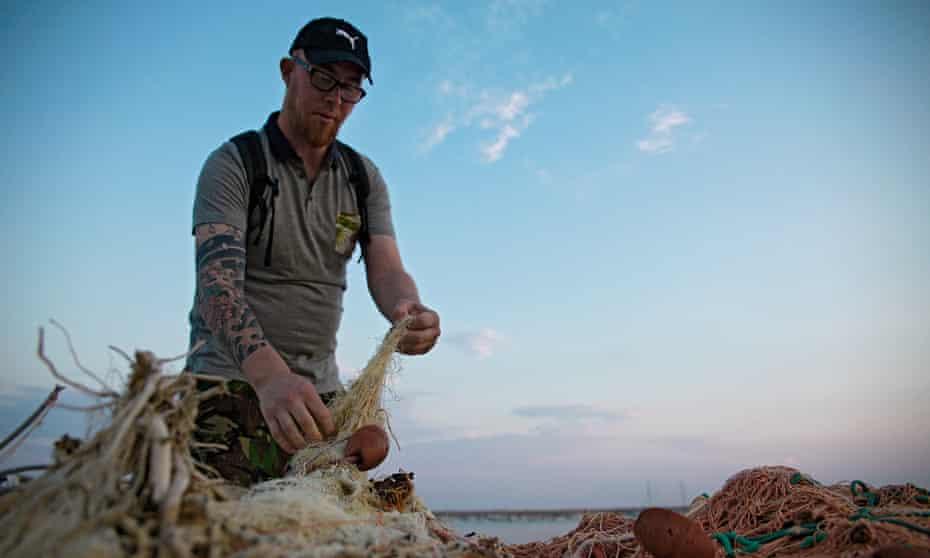 A citizen inspector checks fishing nets in Sant'Agata di Militello, Sicily.