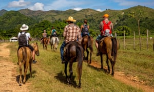 Tourists horse riding in the Valle de los Ingenios