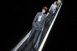 DIOR Kim Jones rejected a traditional catwalk in favour of an impressive 76m conveyor belt spanning the length of the purpose built venue in the shadow if the Eiffel Tower. Models stood statue like and glided passed, heroic. Tailoring and romance were at the heart of the collection. A couture draping technique was explored in detachable satin scarves worn wrapped around the body and draped over the arm. A hand-beaded shirt with Mona Lisa artwork by Raymond Pettibon, took 15 people 1,600 hours to make. Saddle bags got another update in nylon.