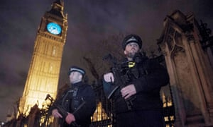 London New Year 2016epa05084769 Armed police officers stand outside of The Queen Elizabeth Tower and The Houses of Parliament in London ahead of the New Years Eve fireworks in, London, Britain, 31 December 2015. Police have increased security for London's New Year's Eve celebrations amid fears of a mass terrorist attack in the capital. EPA/HANNAH MCKAY