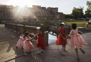 Girls dance during Eid Al Fitr celebrations in the old town of Kashgar, in the far western Xinjiang province, China
