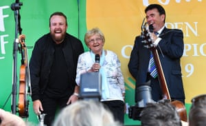 The 2019 Open Champion Shane Lowry and his grandmother Emily Scanlon with MC Des Cahill at his homecoming event in Clara