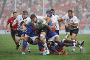 Italy's Jake Polledri is tackled during the match against Namibia at Hanazono Rugby Stadium.