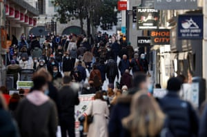 People walk in a street in Nantes amid the coronavirus outbreak in France, on January 25, 2021.
