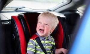 Boy Crying In A Childrens Car Seat