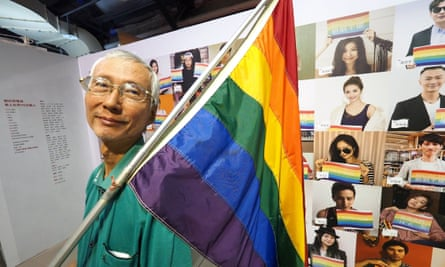 Chi Chia-wei holds a rainbow flag during an anti-homophobia exhibition in Taipei.