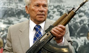 Mikhail Kalashnikov holds an early prototype of his famous rifle in 2007