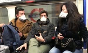 People wear masks on the London Underground