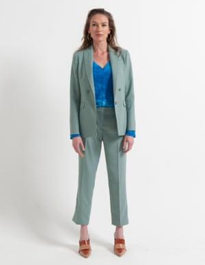 model wears blazer, £285, and trousers, £150, meandem.com. Top, £90.56, michaelstars.com. Mules, £18, asos.com. Hoops, £42, luvaj.com