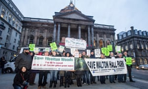 Campaigners protest to save Liverpool's Sefton Park Meadows and Walton Hall Park outside Liverpool town hall.