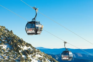 Two cable car cabins moving up to the very top of Chopok mountain at Jasna ski resort - Slovakia