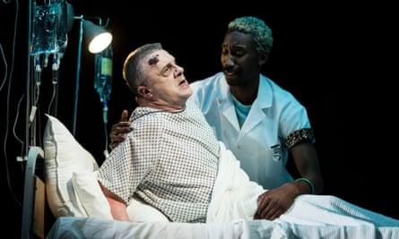 Nathan Lane (Roy Cohn) and Nathan Stewart-Jarrett (Belize) in Angels In America.