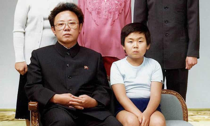 Former North Korean leader Kim Jong-il with his son, Kim Jong-Nam, sitting for a family portrait in Pyongyang.