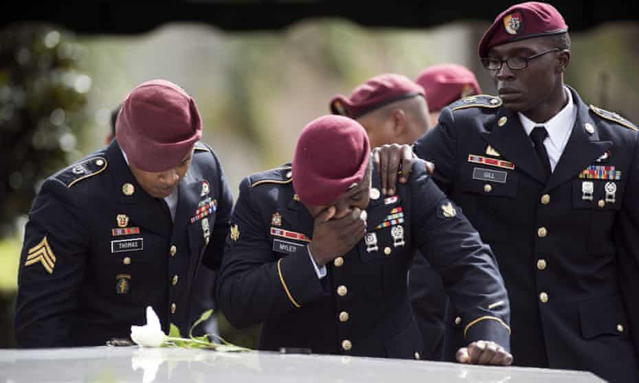 Members of the 3rd Special Forces Group, 2nd battalion cry at the tomb of US Army Sgt La David Johnson at his burial service 21October 2017 in Hollywood, Florida. Johnson and three other US soldiers were killed in an ambush in Niger on 4 October.