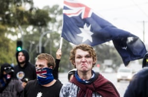 A member of a collective called the True Blue Crew makes an angry face towards anti-fascists during a 'Say no to racism' protest and a counter 'Stop the far left' rally in Coburg, Melbourne on Saturday.