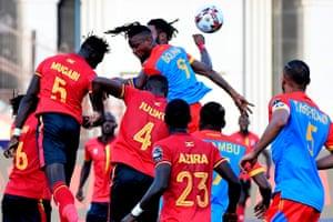 Uganda's defender Bevis Mugabi (left) fights for the ball with Congo's forward Jonathan Bolingi.