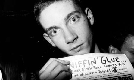 The proto forum ... A punk holds a copy of Sniffin' Glue fanzine.