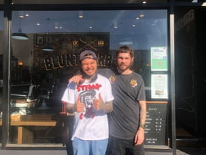 Ken Tu, left, says he can't afford to shut again despite his shop, Blunt Barbers, being in a lockdown suburb. He is pictured with Boedan Nelson.