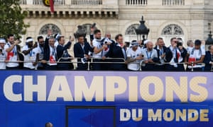 France's players parade down the Champs Élysées with the World Cup trophy