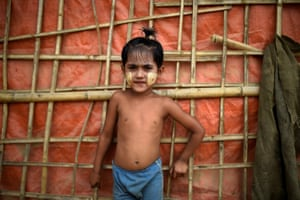 Ahalam, aged 4. The paste is applied to the face in various patterns and dries into a protective layer