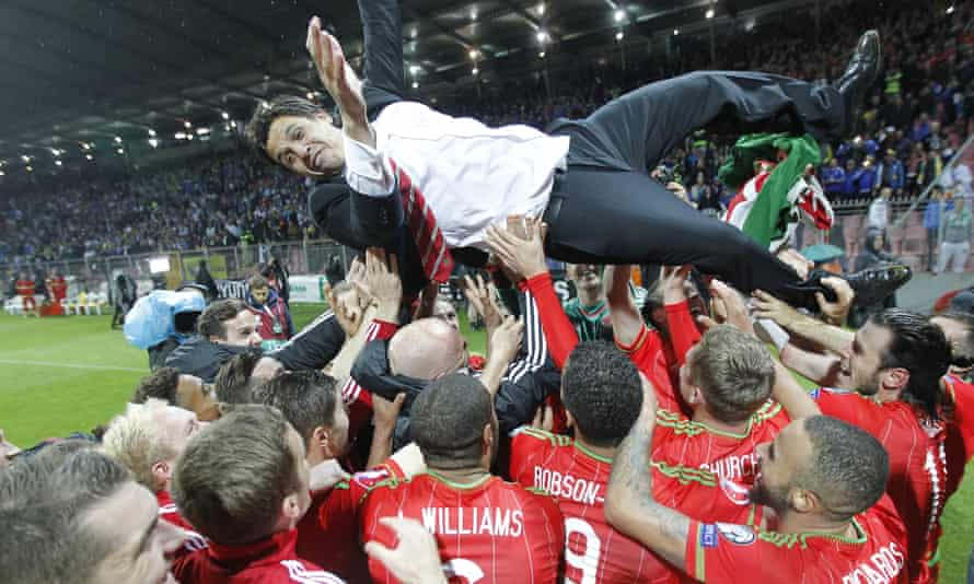 Wales players celebrate Euro 16 qualification with their manager Chris Coleman after their win against Bosnia and Herzegovina in October. But will the addition of smaller nations such as Wales add to the tournament spectacle?