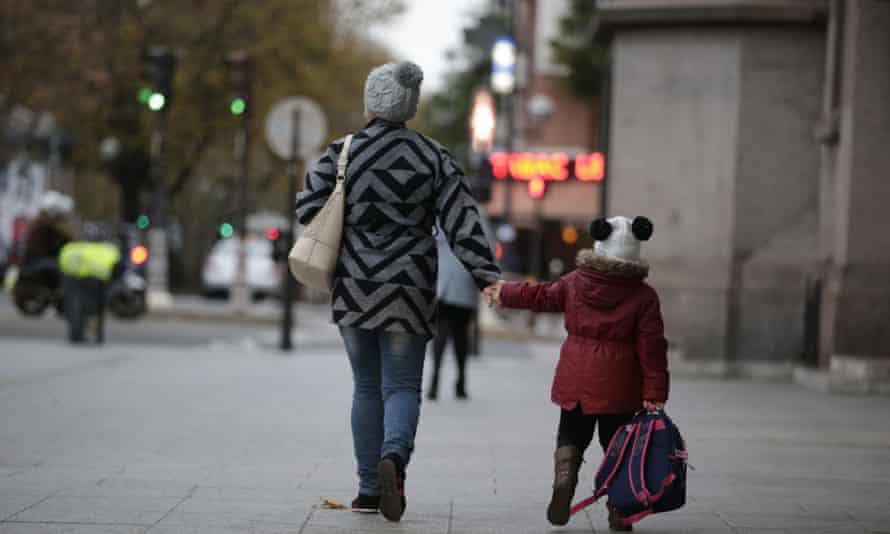 A child on her way to school in Paris on Monday