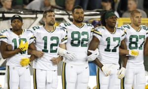 Green Bay Packers link arms during the national anthem before an NFL football game against the Chicago Bears on Thursday in Green Bay, Wisconsin.