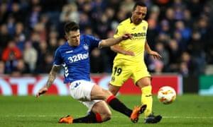 Rangers' Ryan Jack tackles Villarreal's Santi Cazorla, who came off the bench for the La Liga side.