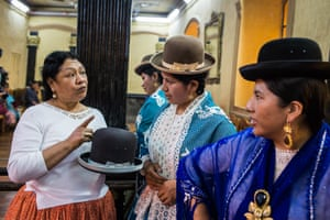 Rosario Aguilar lectures two fashion students about the quality of the Borsalino hats during a modelling sessions at Hotel Torino in La Paz. Aguilar started a company to promote the work of fashion designers that produce clothes for cholitas, but noticing the lack of professional models to show the designs, she decided to create a modelling school that teaches indigenous women how to model on a catwalk and at various promotional events