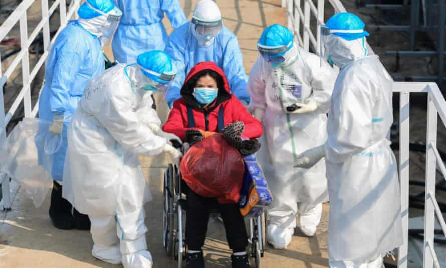 Medical workers with a patient at the new hospital in Wuhan, China, February 2020