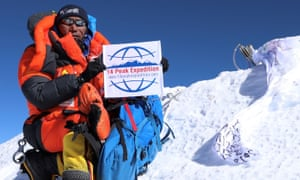 Kami Rita Sherpa poses at the top of Mount Everest after reaching its summit for the 23rd time last week.