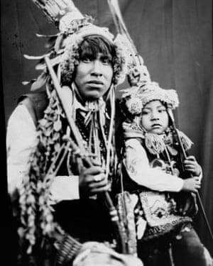 Rudy Espiriya and his three-year-old son Dayiro Tahuara pose for a portrait in the Sinakara Valley, in Peru's Cusco region, during the Qoyllur Rit'i festival. The pair perform a dance called paapuri guayri as part of the Paucartambo nation