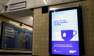 A poster at a London tube station encourages EU nationals to apply to the settlement scheme