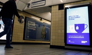 A poster, aimed at EU citizens living in the UK, encourages EU nationals to apply to the Government's post-Brexit EU settlement scheme, is pictured at South Kensington underground station in London.