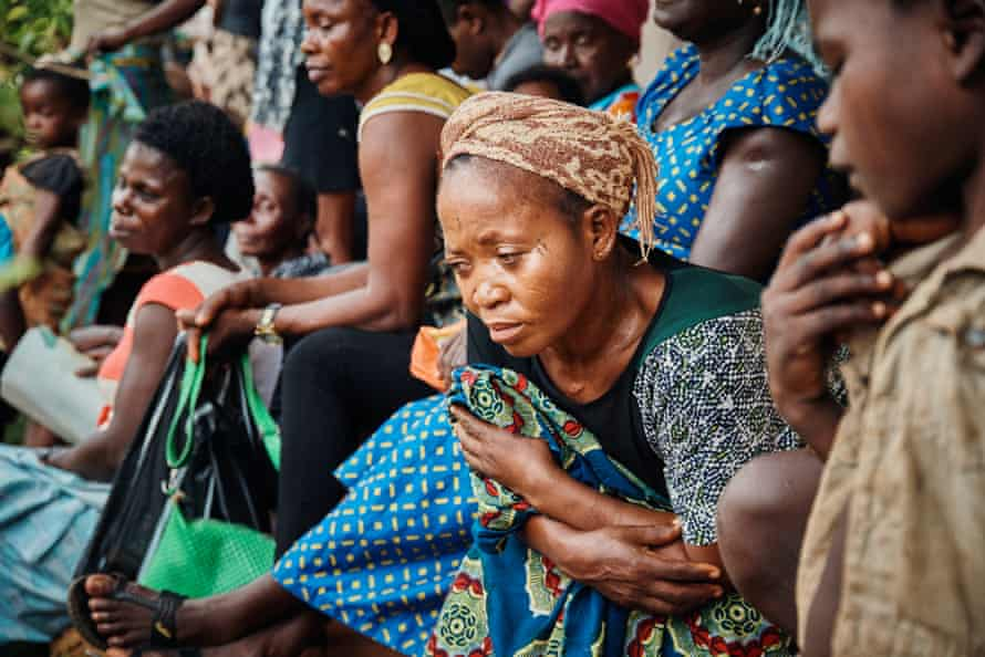 Cameroonian refugees in Cross River State, Nigeria, wait outside a health post in Ekang village.