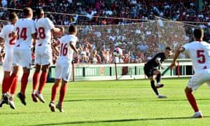 Harry Wilson takes a free kick.