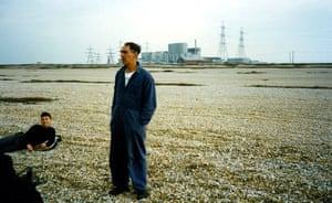 Derek Jarman, Dungeness 1989: wearing his distinctive blue overalls, Jarman talks to Liam Daniel and the crew during a break from filming. Derek Brown recorded the filming.