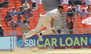 A flying James Anderson flings a delivery down the wicket.
