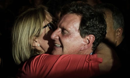 Marcelo Crivella embraces his wife, Sylvia Jane, after his election victory.