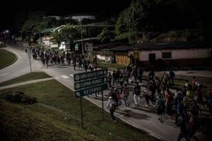 San Pedro Sula, Honduras: people walk along a road as part of a new caravan of migrants heading to the US