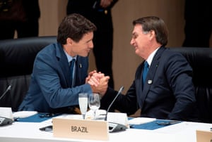 Trudeau (left) greets Brazil's president, Jair Bolsonaro