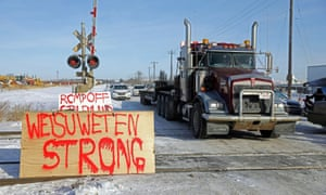 Supporters of the indigenous Wet'suwet'en Nation's hereditary chiefs camp at a railway blockade as part of protests against British Columbia's Coastal GasLink pipeline, in Edmonton, Alberta, on Wednesday.