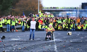 Protesters face riot police as they block a motorway in Virsac, near Bordeaux, November 2018