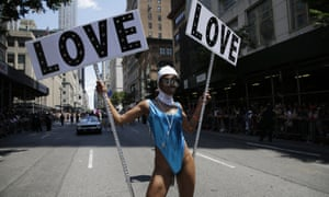Pride goer with big LOVE banners