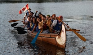 Canada's prime minister, Justin Trudeau, paddles in a a voyageur canoe on the Ottawa River following the National Aboriginal Day Sunrise Ceremony in Gatineau, Quebec, on Tuesday, June 21, 2016. The federal government began observing National Aborginal Day on June 21 two decades ago. (Sean Kilpatrick/The Canadian Press via AP) MANDATORY CREDIT