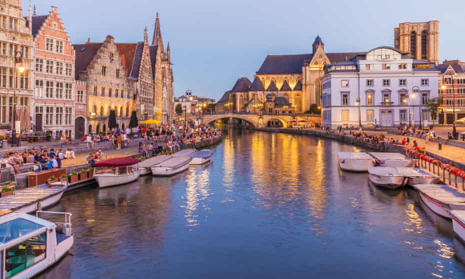 Golden reflections: the River Leie flowing through Ghent's old town.