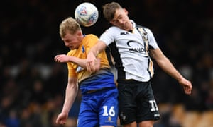 Port Vale's Luke Hannant, right, challenges Willem Tomlinson of Mansfield Town during a vital win for the Burslem club.